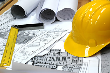Hard hat on building plans